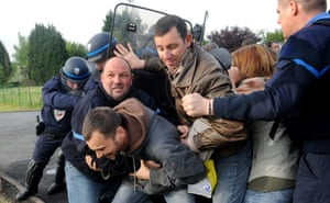 French CRS riot police clash with prison guards at the Sequedin remand centre, northern France. Prison guards blocked the access to the centre for three hours this morning to protest against a lack of security measures at the jail, after an escape last month.