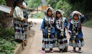 Little girls of the Bailuo people attend their traditional Qiaocai Festival at Chengzhai Village in Malipo, China.