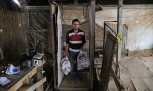 Special delivery. A man comes up from the underground tunnel beneath the Gaza-Egypt border with KFC food in Rafah, Gaza Strip. The Al-Yamama delivery company started to bring food from the Egyptian north Sinai
