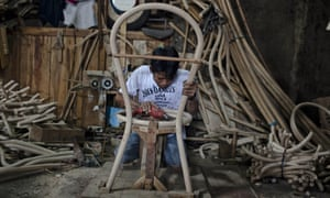 A worker makes chair frames to be woven with rattan at a workshop manufacturing furniture in Trangsan a village near Sukoharjo, Central Java, Indonesia.