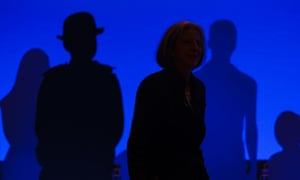 The shadowy figure of home secretary Theresa May, walks on stage before making a speech to the Police Federation of England and Wales annual conference in Bournemouth, Dorset.