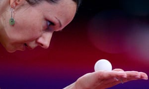 Keeping her eye on the ball, Ruta Paskauskiene of Lithuania serves to Xiaoxia Li of China during their women's single first round match of the World Table Tennis Championships in Paris.