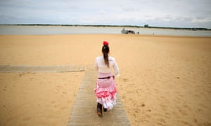 A pilgrim makes her way to the shrine of El Rocio in Sanlucar de Barrameda, southern Spain. Every spring, hundreds of devotees converge at the shrine to pay homage to the Virgin del Rocio.