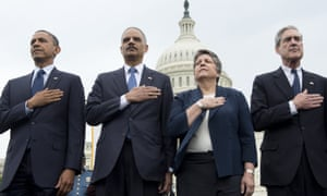 US President Barack Obama, Attorney General Eric Holder, Secretary of Homeland Security Janet Napolitano and Director of the FBI Robert Mueller stand during the National Anthem at the national peace officers memorial service, an annual ceremony honouring law enforcement officers who were killed in the line of duty in the previous year, at the US Capitol in Washington, DC.