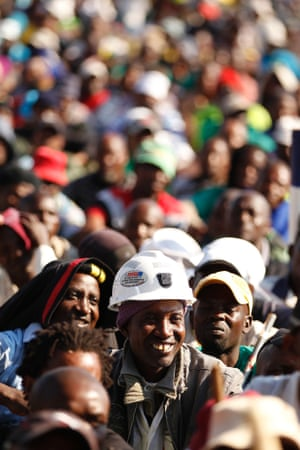 Miners listen to their leaders during a strike at Lonmin's Marikana platinum mine in Rustenburg, South Africa. The main union behind a two day strike at Lonmin's South African operations told workers to return to work on Wednesday's night shift.