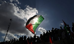 A Palestinian flag is pictured against a dramatic sky as Palestinians  protest during the Nakba Day march in Damascus Gate, Jerusalem. Nakba Day is the annual day to commemorate the displacement of Palestinians after the establishment of the state of Israel in 1948.