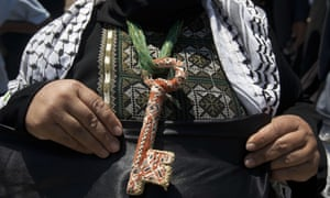 A Palestinian woman wears a key around her neck symbolizing the homes people lost in 1948 when the Jewish state of Israel was created, at the rally.