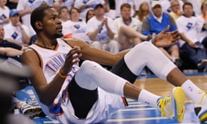 Oklahoma City Thunder Forward Kevin Durant Falls To The Floor After Taking A Charge Against