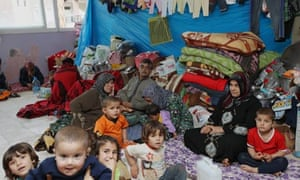 Refugees shelter in the Turkish town of Reyhanli, near the border with Syria