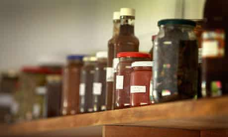 shelf full of home produce jars of chutney in larder room