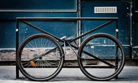 Bicycle Wheels Locked to Bike Rack