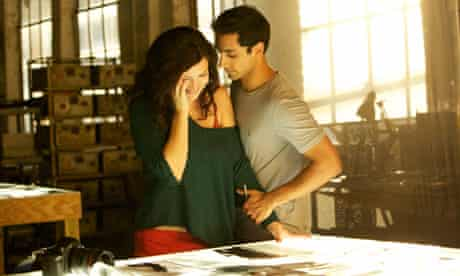 Riz Ahmed as Changez with Kate Hudson as Erica in the film The Reluctant Fundamentalist