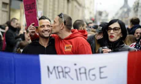 A man kisses his companion during a demonstration in France for legalisation of same-sex marriage