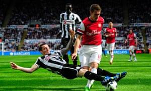 Mathieu Debuchy tackles Aaron Ramsey