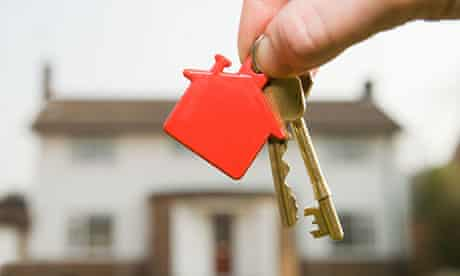 Person holding door keys Person holding house keys