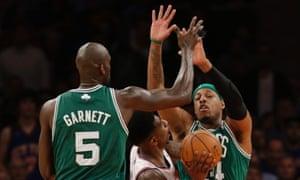 8a39b70b3d8 Boston Celtics center Kevin Garnett (5) and forward Paul Pierce (34) double