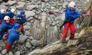 School children take part in a rock climbing exercise