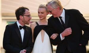 Ethan Coen, Carey Mulligan and musician T-Bone Burnett leave Sunday evening's screening of Inside Llewyn Davis at Cannes