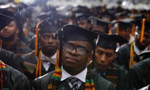 A graduate watches through rain-soaked glasses as  President Barack Obama delivers an address during the graduation ceremony of the class of 2013 at Morehouse College in Atlanta, Georgia.
