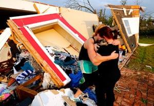 Tornado in USA: Alli Christian, left, returns Jessica Wilkinson's dog