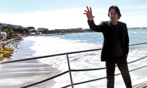 Keanu Reeves poses during a photocall to present his film Man of Tai Chi.