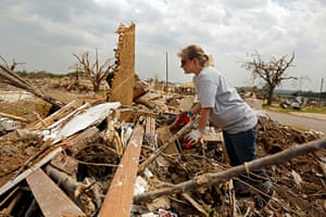 Tornado in USA: A woman searches the remains of her home for valuables in Granbury