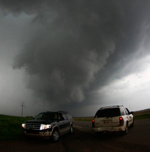 Storm chasers get close to a tornadic thunderstorm, in South Haven, Kansas