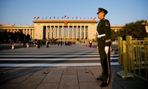 A police officer stands guard on Tiananmen Square