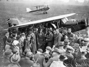 American aviator Amelia Earhart is surrounded by a crowd of wellwishers and pressmen on arrival at H