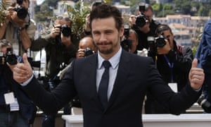"""James Franco gives thumbs-up on May 20, 2013 while posing during a photocall for the film """"As I Lay Dying""""."""