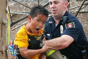 A boy is pulled from beneath a collapsed wall at the Plaza Towers Elementary School, Oklahoma.