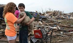 Children comfort dog after Oklahoma tornado