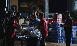 Members of the American Red Cross distribute food at a command centre the day after a killer tornado hit in Moore, Oklahoma.