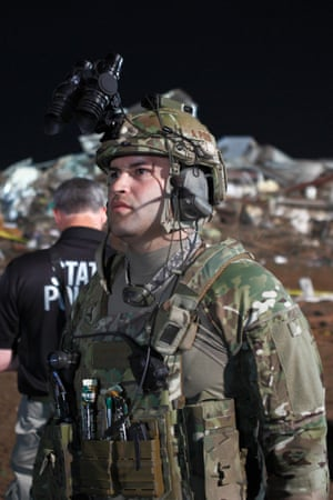 An Oklahoma National Guard soldier pauses during rescue efforts.