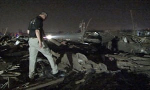 Oklahoma National Guard soldiers and airmen working with emergency crews as they look for survivors.