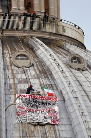 "Italian businessman Marcello De Finizio stands on the dome of St Peter's basilica to protest against austerity measures on May 21, 2013 at the Vatican. The businessman hung  a banner saying: "" Stop this massacre, the political horror show is continue....help us Pope Francis... "".     AFP PHOTO / ANDREAS SOLAROANDREAS SOLARO/AFP/Getty Images VERTICAL"
