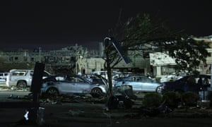 Damaged cars rest in the car park of Moore Medical Centre the day after the tornado.