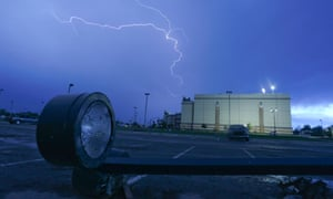 Lightning rips across the sky over Warren Theatre the day after a tornado hit in Moore.