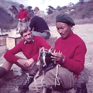 everest: Tenzing Norgay holding crampons