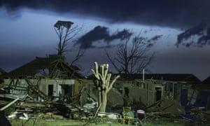 A destroyed neighborhood the day after a tornado hit.