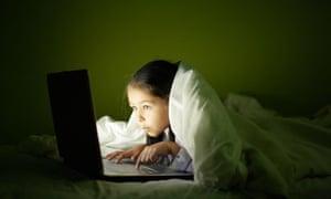 Girl using laptop at night