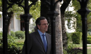 Greek prime minister Antonis Samaras after his meeting with Greek president Karolos Papoulias. Photograph: AP Photo/Petros Giannakouris