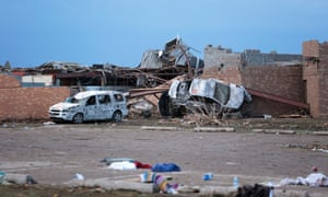 Cars lie around the northeast corner of Plaza Towers Elementary school after it was damaged by a tornado. The town reported a tornado of at least EF4 strength and two miles wide that touched down yesterday killing at least 24 people and levelling everything in its path.