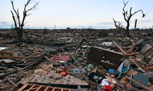 The rubble of a destroyed neighborhood is strewn about a neighborhood.  Many homes were stripped to their foundations Monday by a tornado which moved through the area.