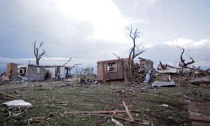 Debris lies around homes one block north of Plaza Towers Elementary school after the area was damaged by a tornado.