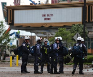 Members of Nebraska Task Force wait to be deployed as they stand in the Warren Theatre parking lot the day after a killer tornado hit in Moore, Oklahoma.