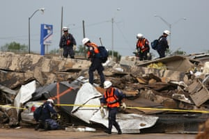 Members of Nebraska Task Force 1 search a destroyed building the day after a killer tornado hit. Photograph: Ed Zurga/EPA