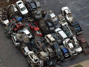 Damaged vehicles from Monday's tornado can be seen in the parking lot of the Moore Medical Center. Photograph: Tony Gutierrez/AP
