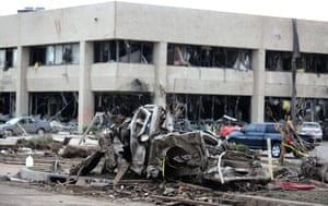 A mangled car rest near damaged Moore Medical Center. Photograph: Ed Zurga/EPA