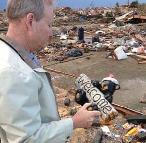 Mayor Mick Cornett looks over some of the tornado damage in Moore